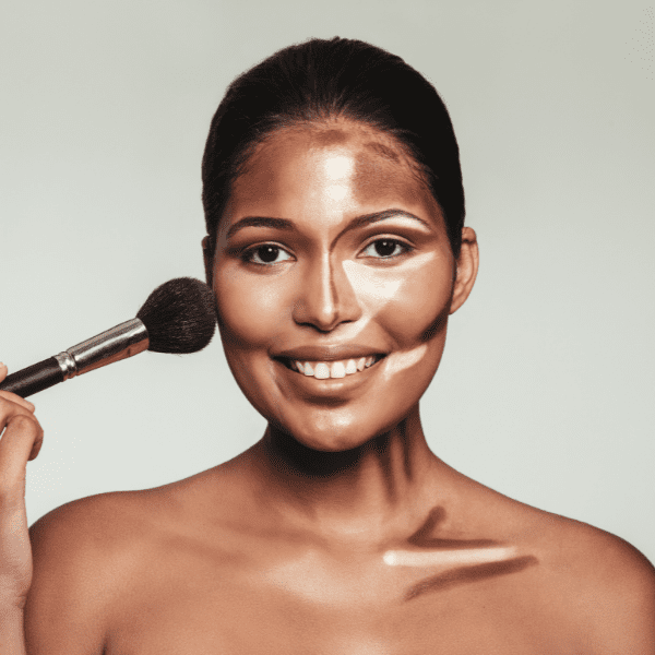 Beautiful woman applying contour to accentuate her best features